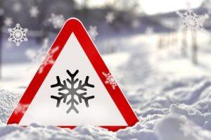 Eis - Warnschild mit Schnee